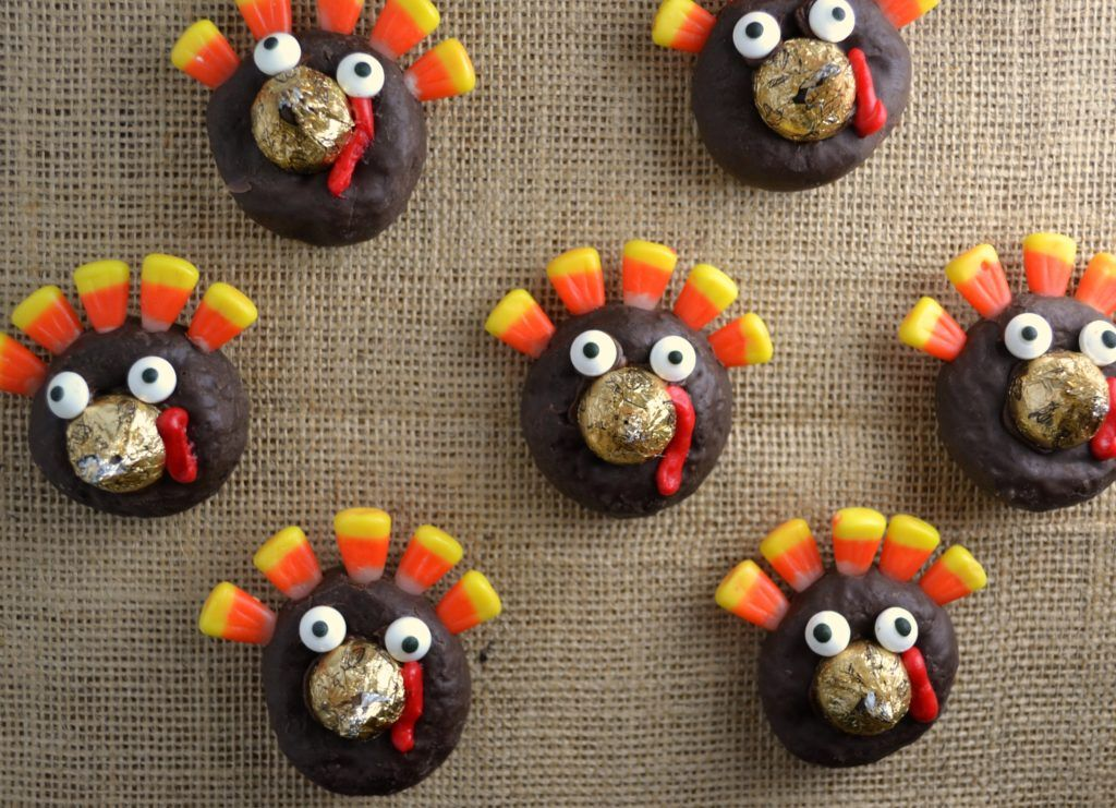 3 row of mini turkey donuts on a brown burlap placemat