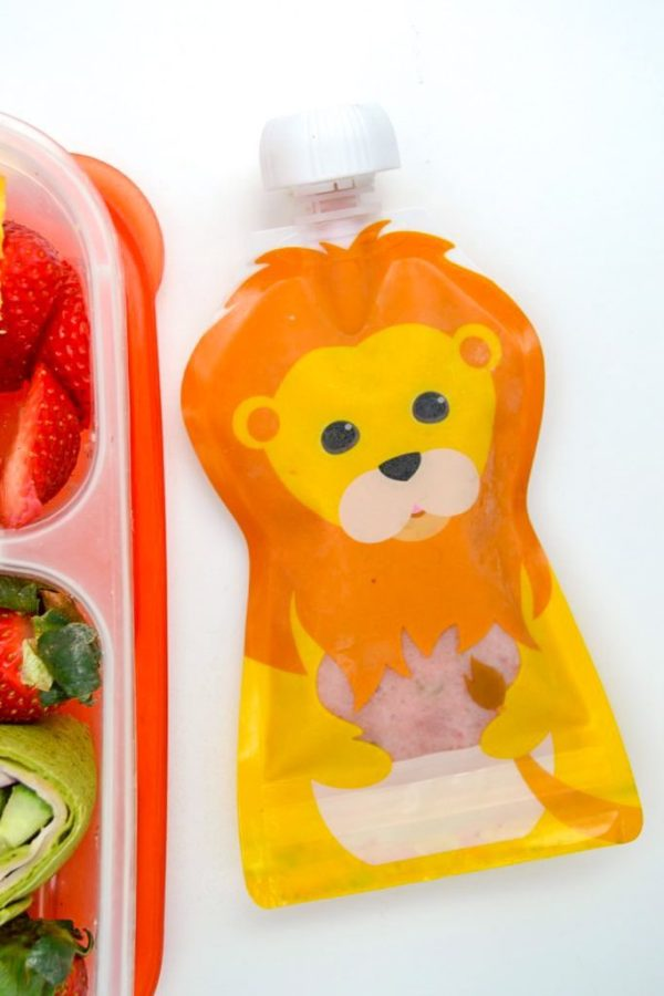 lion pouch made by squooshi and filled iwth a fruit and veggie smoothie