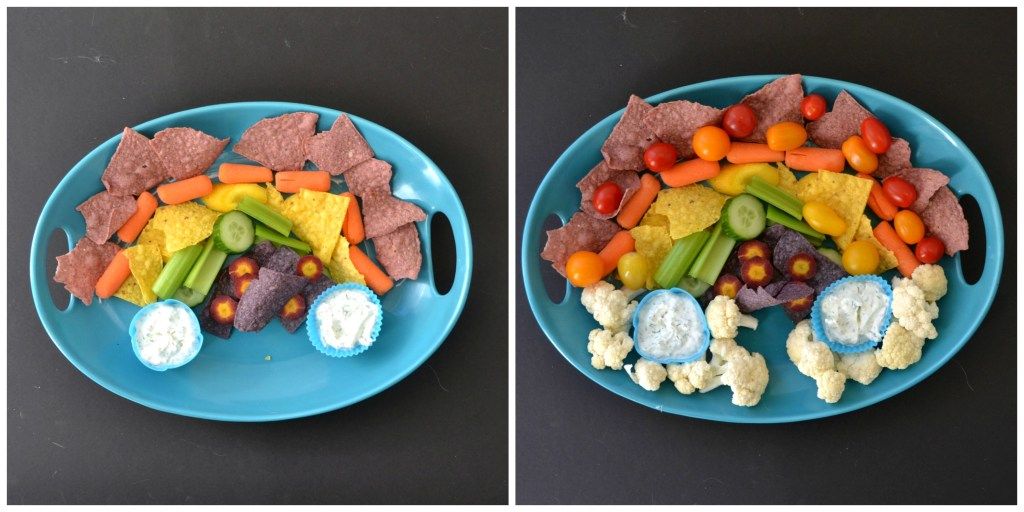 platter of chips and veggies in a rainbow pattern on a blue platter with healthy veggie dip in blue silicone cups