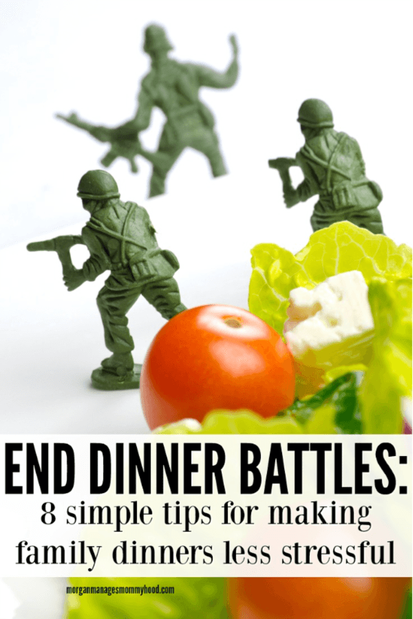 green toy soldiers are standing on a plate protecting a dinner salad to avoid dinner time battles
