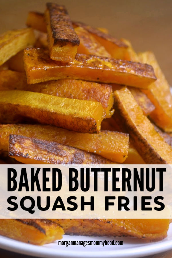 a stack of butternut squash fries on a white plate with a brown wood background