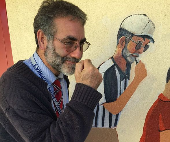 Cabrillo Middle School Principal Stan Garber showcases the accuracy of the mural.