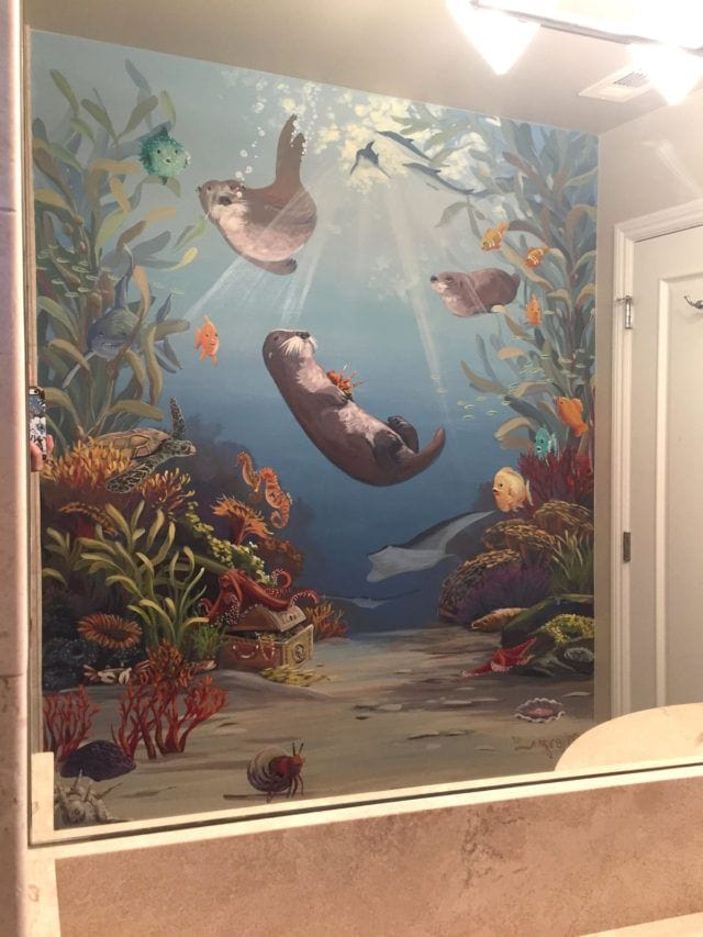 Underwater mural in California residence with otters and kelp forest
