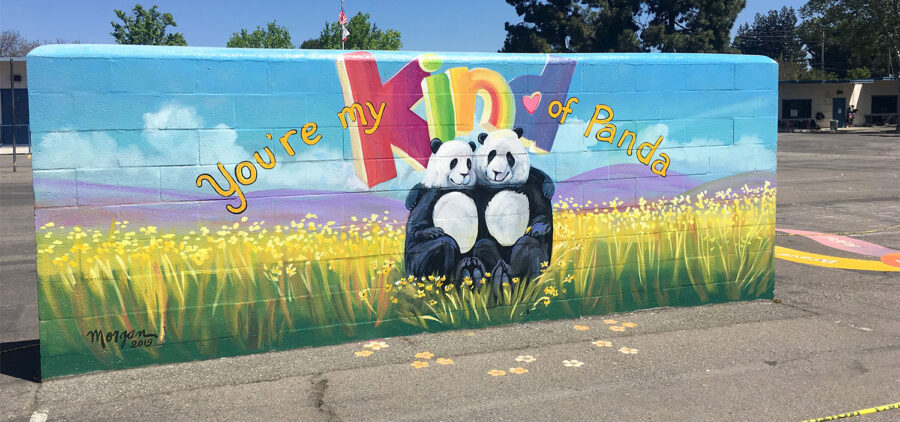 Hired to paint flowers and pandas... being a school muralist is so much fun!