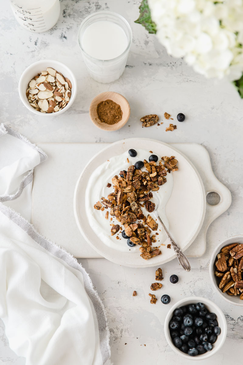 This quick and easy Grain Free Tahini Granola is loaded with toasted nuts and coconut flakes all baked with the perfect tahini honey coating. It'll quickly become your favorite grain free snack!