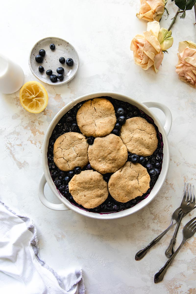 Grain-Free Tahini Blueberry Cobbler with a crunchy grain-free tahini cobbler topping and a naturally sweetened blueberry filling. Healthier than regular cobbler but just as tasty!