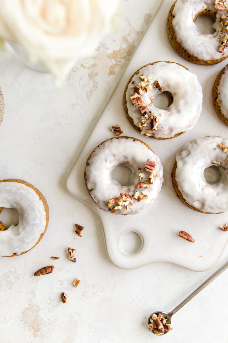 Moist and tender Pumpkin Donuts made grain and gluten-free with an added boost of collagen protein! These pumpkin donuts are the perfect baked healthy treat for fall weekends!