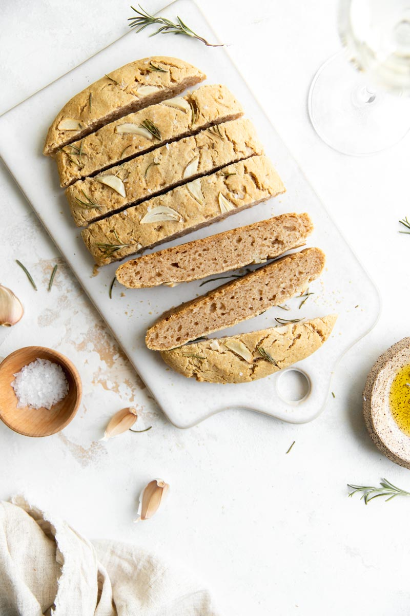 Savory, herby Grain-Free Garlic Herb Focaccia goes perfect with a glass of wine and a cheese board, or just a bowl of flavorful olive oil! Made with cassava flour for the most delicious gluten and grain-free focaccia.