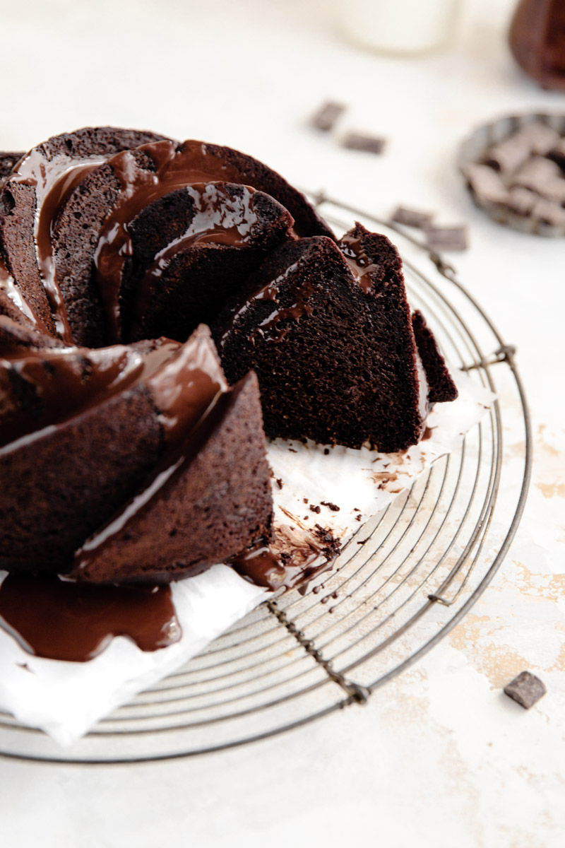 Decadent Grain-Free Double Chocolate Bundt Cake made with cassava flour, canned pumpkin, and a dairy-free chocolate glaze. The perfect grain-free chocolate cake for any occasion!