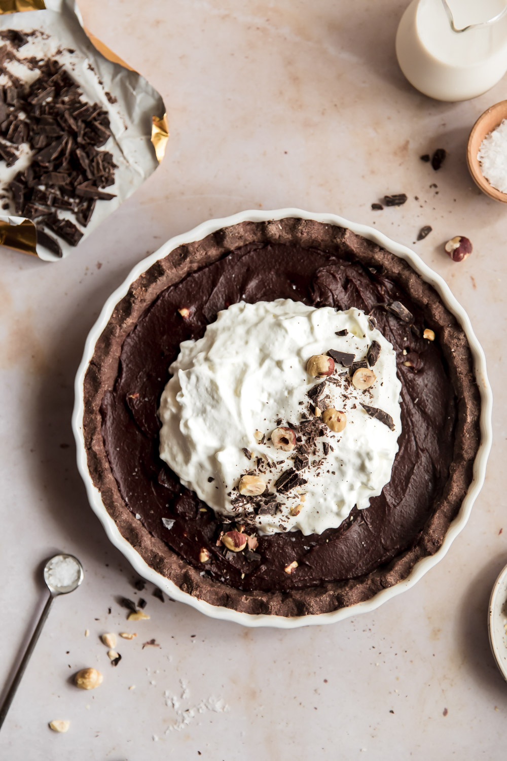 If you're looking for a healthy chocolate holiday treat, look no further than these Chocolate Hazelnut Tahini Ganache Tarts, gluten and dairy-free and low in sugar!