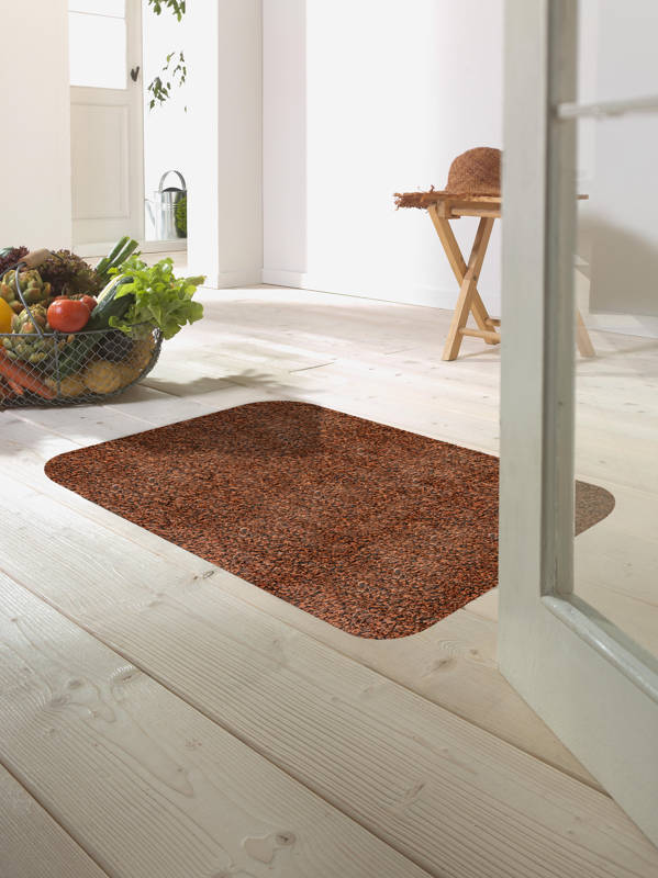 Morland cotton doormat in colour cinnamon on on a wooden floor in a bright room by a bowl of fruit