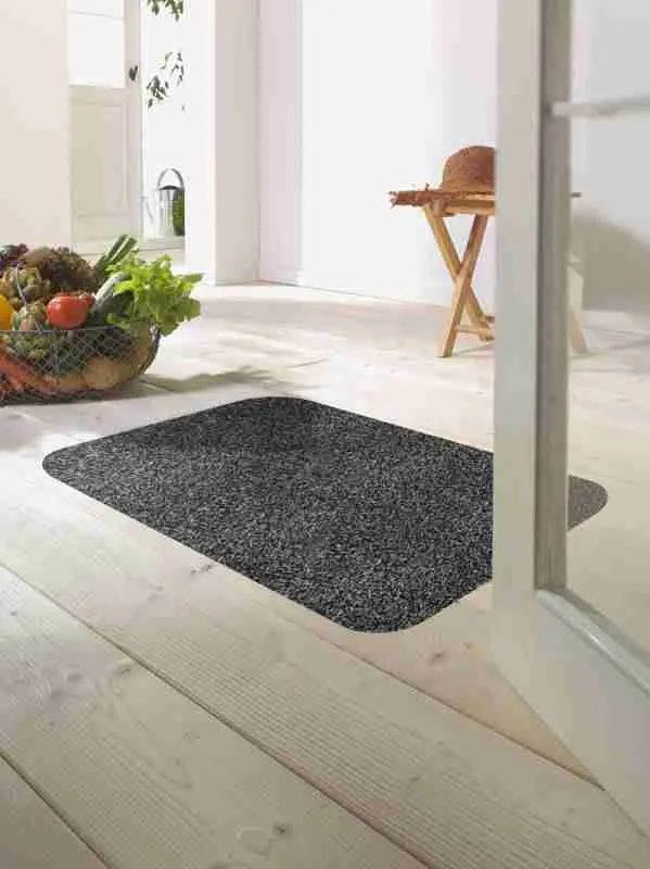 Morland cotton doormat in colour slate on on a wooden floor in a bright room by a bowl of fruit