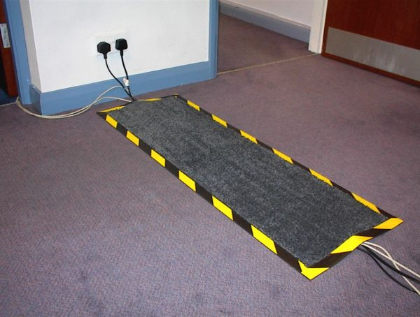 Photograph of Morland cable Protect mat covering cables in an office