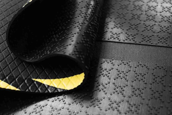 Close up of Morland Cable Protect Rubber Mats showing cable channel, multi-grip backing and top embossed surface of mat