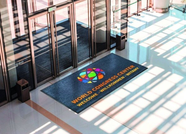 Large logo doormat by conference entrance door