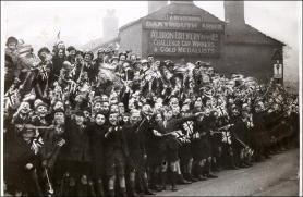 Morley School children await the Royal motorcade during a Northern tour