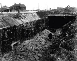 Removing the cover of the railway tunnel under Gildersome crossroads during the construction of the M62