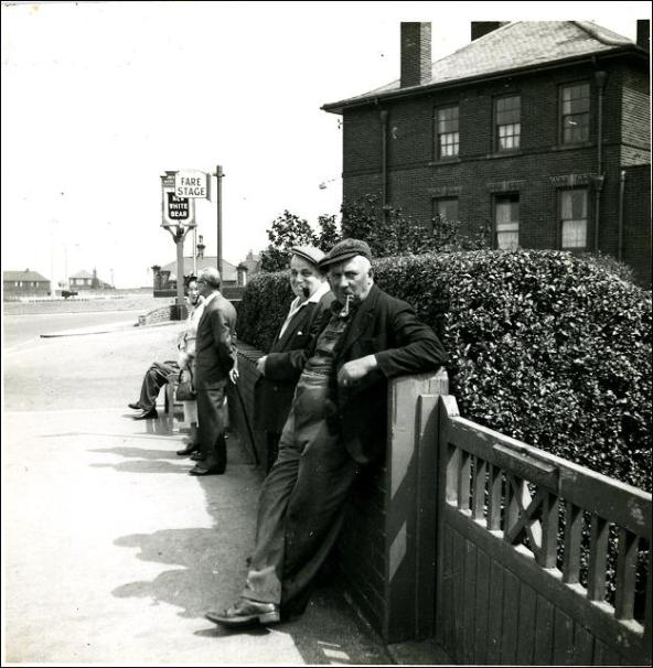 George Slingsby and others waiting for a bus outside The New White Bear, Tingley