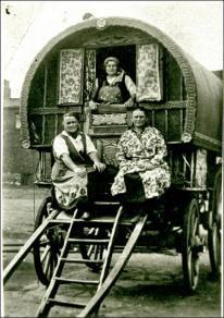 Gypsy caravan and occupants at Brow Wood, Morley