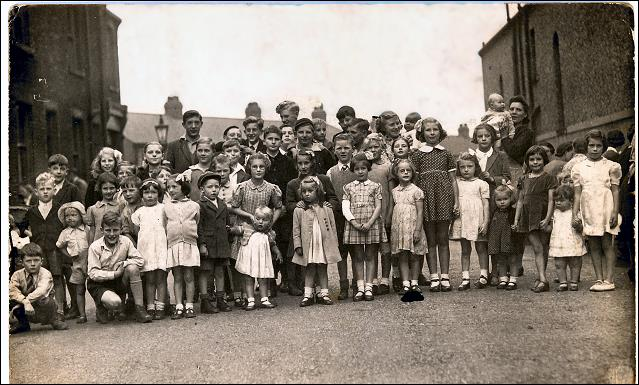 Group photo of children at V.E. party held in Gilroyd Terrace, Morley