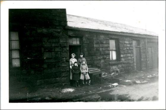 Two adults and two children at Hopewell Farm
