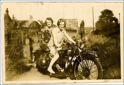 Two women on a motorbike in Morley