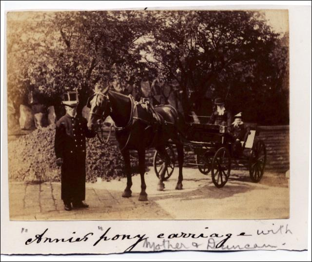 Annie Watson with grandson Duncan outside Croft House in the horse drawn carriage