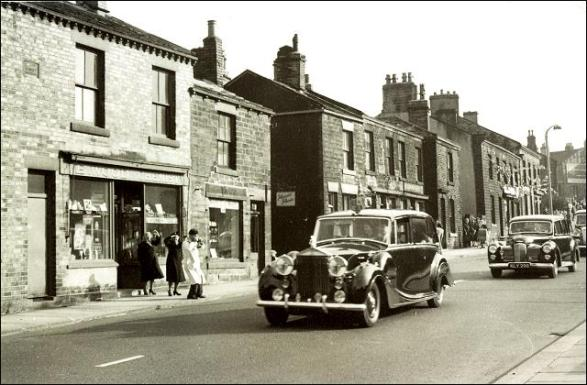 The motorcade of Queen Elizabeth II and Prince Philip in King Street Drighlington