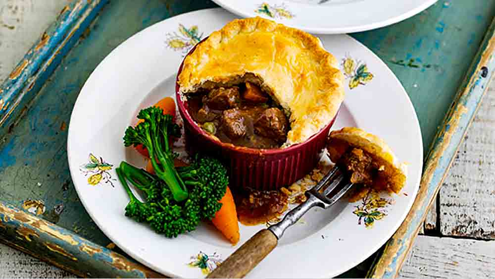 individual beef and ale pie on a plate