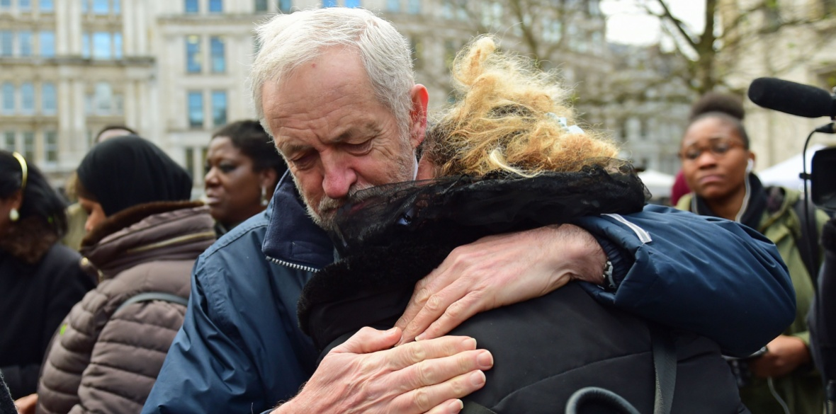 Jeremy Corbyn hugs a woman after the Grenfell Tower National Memorial Service at St Paul's Cathedral in London