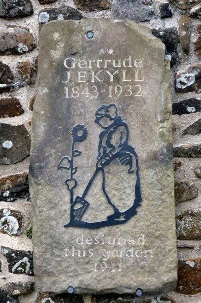 A plaque commemorating Gertrude Jekyll, outside the garden on Lindisfarne which she designed