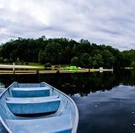 Boat in sunrise lake at Lewis Morris Park