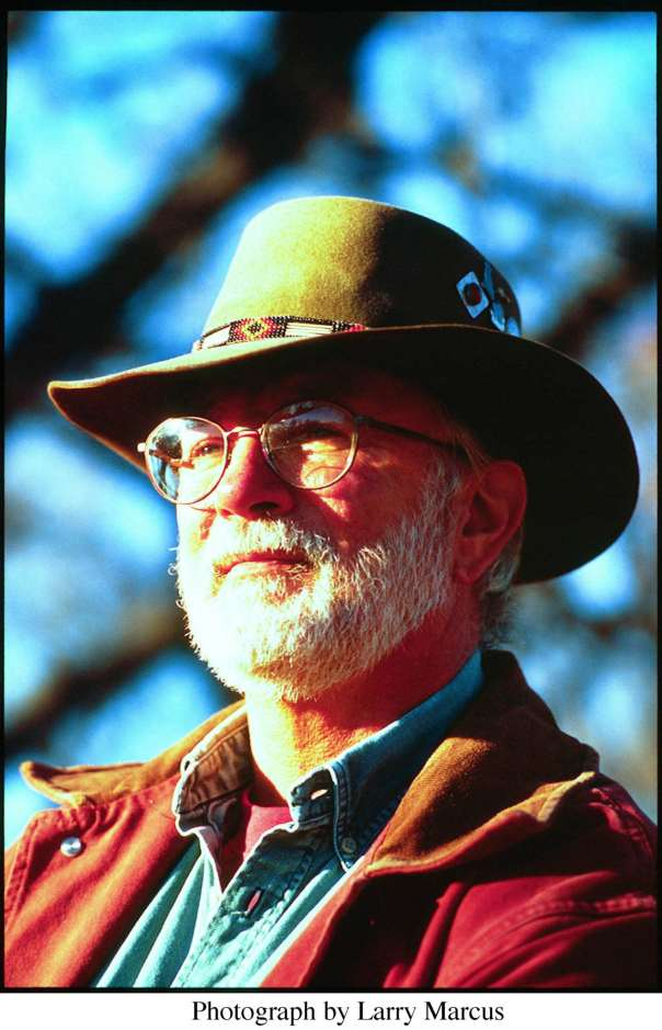 Bill Staines outdoors in hat