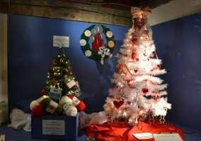 white Christmas tree and green Christmas tree