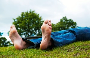 Healthy bare feet lying on the grass