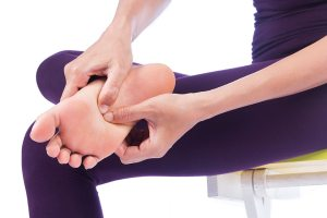 Woman massaging the pain out of her feet