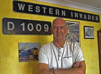 Class 52 fan, Neil Carter, with the Western Invader nameplate and D1009 cabside numberplate, which he has reunited after 40 years. SCOTT LEWIS