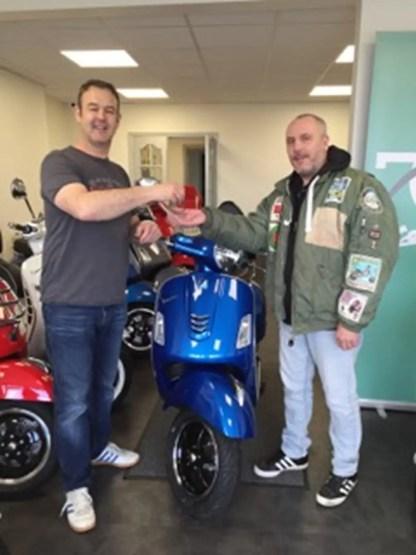 Mark 'Maca' McDonald taking delivery of his new Vespa from Sean Nash of Moto Continental, Birmingham