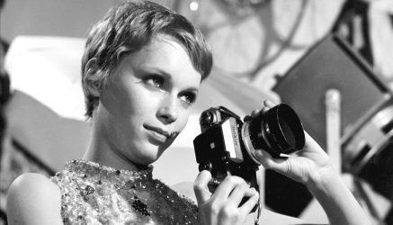 © ABACA. 57551-106. 1968. Dandy in Aspic. Mia Farrow as photographer with her Nikon camera.