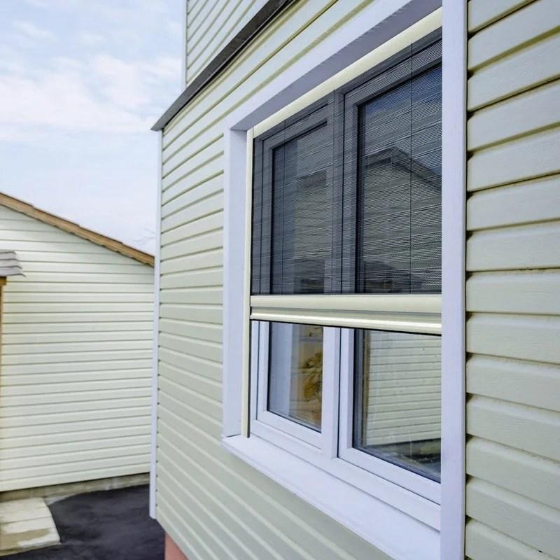 Mosquitera plisada para ventanas y puertas de accionamiento vertical