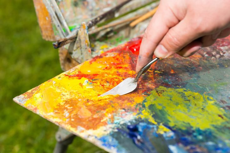 Painter Mixing Colors Of The Paint On Palette By The Palette Knife Outdoors