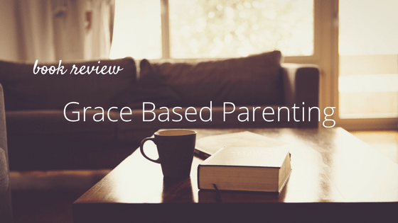 couch, coffee table, cup. text: Book Review: Grace Based Parenting