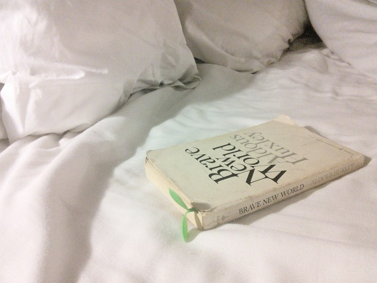 white bed linens, with book