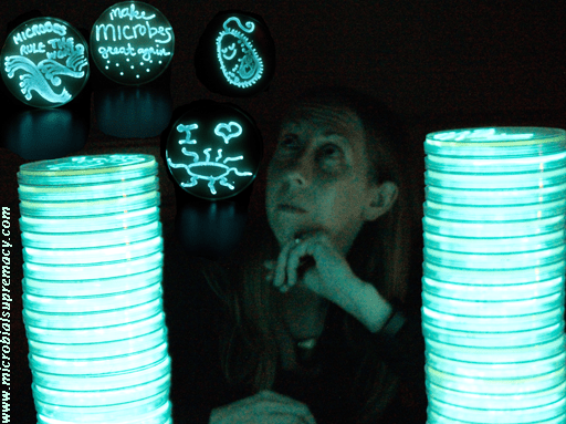 Photo of Anne lit by 2 stacks of glowing bacteria .