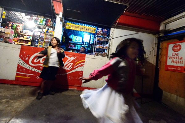 Kids at the base cafe, twirling.