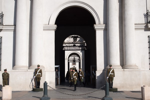 Guards outside La Moneda, Chile's presidential palace.
