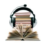 headphones around stack of books stock photo