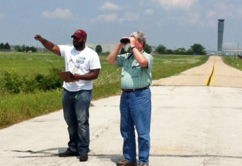 Aullwood staff, Tom Hissong and Robert Shelly collect bird data at the Dayton Airport