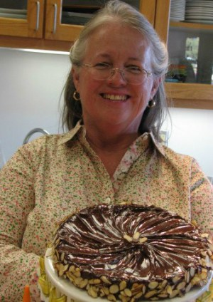 Zebbie Borland with a delicious looking Almond Cake