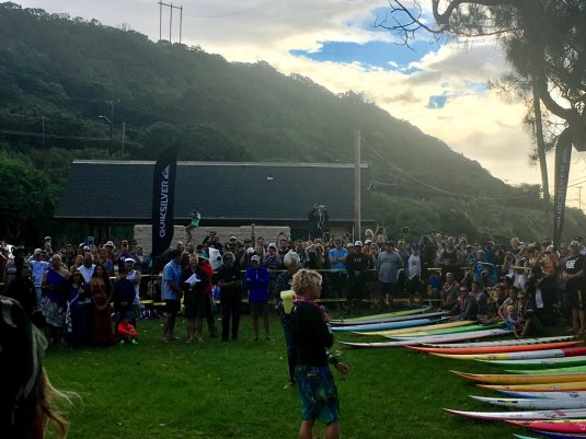 Defending champion John John Florence addresses his fellow invitees and the crowd at the opening ceremony for the Eddie. Photo: Anthony Olegario.